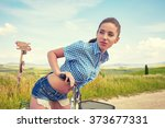 sexy woman with vintage bike in ... | Shutterstock . vector #373677331
