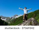 happy boy in caucasus mountains | Shutterstock . vector #37369342