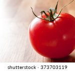 close up of a fresh tomato on a ... | Shutterstock . vector #373703119