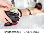 the man pays a prostitute with... | Shutterstock . vector #373716061