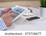 businessman holding digital...   Shutterstock . vector #373718677