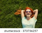Relaxing Redhead Girl Lying On...