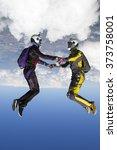 two girls in free fall. | Shutterstock . vector #373758001