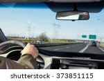 hand of man driving on a... | Shutterstock . vector #373851115