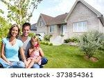 happy family near new house. | Shutterstock . vector #373854361