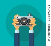 hands holding photo camera... | Shutterstock .eps vector #373891471