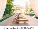umbrella and chair deck in... | Shutterstock . vector #374006995