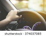 female driving car  left driver  | Shutterstock . vector #374037085