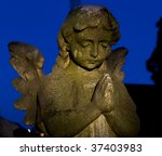 Cemetery Headstone Of A Winged...