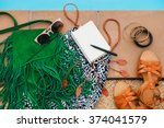 woman's accessories composed on ... | Shutterstock . vector #374041579