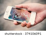 hands holding broken mobile... | Shutterstock . vector #374106091