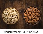 almonds and cashews in bowl on... | Shutterstock . vector #374120365