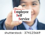 Small photo of Businesswoman holding card with Employee Self Service (ESS) message.