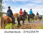 Stock photo group of horseback riders ride in iceland 374135479