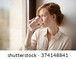 girl drinking water sitting on... | Shutterstock . vector #374148841
