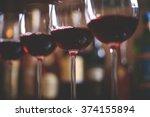row of elegant wine glasses... | Shutterstock . vector #374155894