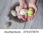 easter eggs in the hands of a... | Shutterstock . vector #374157874