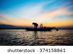 Silhouette Of Fishermen On...