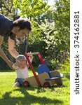 father helping his son in... | Shutterstock . vector #374162881