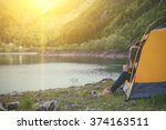 Girl Hiker In A Tent And...