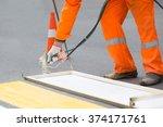 road worker painting zebra... | Shutterstock . vector #374171761