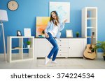 happy young woman with... | Shutterstock . vector #374224534