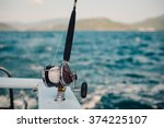 Boat Fishing Rods Over A...