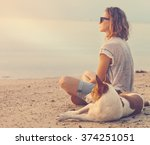 Young Woman With Her Dog On Th...
