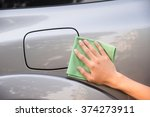 Hand with man cleaning car with green microfiber cloth - stock photo