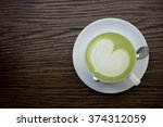 green tea latte on wood... | Shutterstock . vector #374312059
