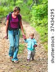 mother walking with kid in the... | Shutterstock . vector #37434295