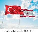 Turkey & Turkish Republic of Northern Cyprus Flags are waving in the sky - stock photo