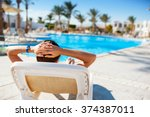 happy woman lying on a lounger... | Shutterstock . vector #374387011