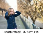 young woman outdoors on a... | Shutterstock . vector #374394145