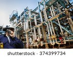 oil worker and ginat pipelines... | Shutterstock . vector #374399734