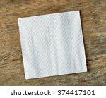 white paper napkin on wooden... | Shutterstock . vector #374417101