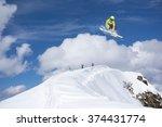 flying skier on mountains.... | Shutterstock . vector #374431774