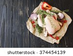 raw chicken with herbs spices... | Shutterstock . vector #374454139