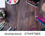 artist supplies on the wooden... | Shutterstock . vector #374497885