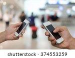 two businessmen using mobile... | Shutterstock . vector #374553259