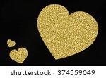 gold giltter heart on black...   Shutterstock . vector #374559049