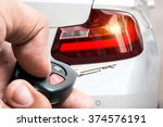 Small photo of Men's hand presses on the remote control car alarm systems