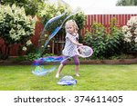 Girl Playing With Soap Bubbles...