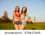 two young sexy girls holding... | Shutterstock . vector #374617645