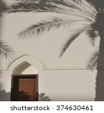 Palm Tree Shadow Falls On A...