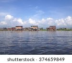 Stilted Houses In Village On...