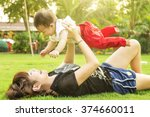 young mother rising baby up. | Shutterstock . vector #374660011