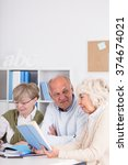 elderly students are studying... | Shutterstock . vector #374674021