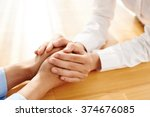 hands of woman reassuring her... | Shutterstock . vector #374676085