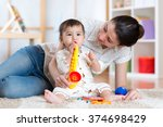mom and baby playing musical... | Shutterstock . vector #374698429
